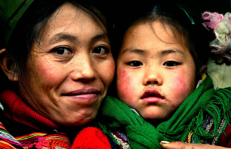Yi mother and child. Meigu, China