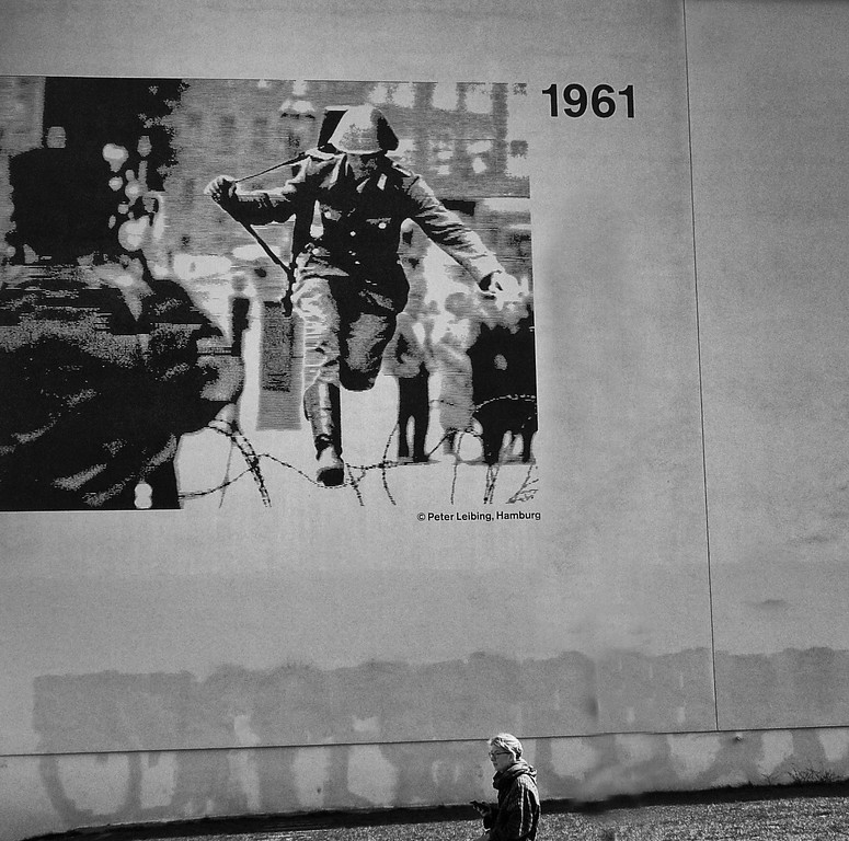 Wait for me! East German soldier Johann SchumannJumping the wire to freedom.