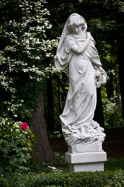 "The statue, ""Winter"", holding pine cones in her left hand."