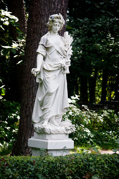"One of the four marble statues in commemoration of the four seasons in the Yaddo garden. This one is called ""Autumn""."
