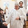 Seminarian Tim Pick received a fist bump after the graduation Mass.