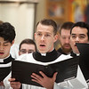 Dcn. Kolbe Elbert, center, sang in the choir during the graduation Mass on May 13.