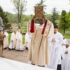 Br. David N'Djam, OSB, leads the procession into the Archabbey Church for the deacon ordination on April 22.