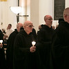 The monastic community processes into the Archabbey Church for the Office of the Dead for Archbishop Emeritus Daniel Buechlein, OSB, on Wednesday, January 31, 2018. <br /> <br />  Benedictine monks pictured, from left, Fr. Germain Swisshelm, Fr. Luke Waugh (partially covered), Br. Mario Ibison, Fr. Adrian Burke, and Fr. Patrick Cooney.