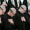 Four men professed solemn vows as Benedictine monks of Saint Meinrad Archabbey in a ceremony on January 25, 2019, in the Archabbey Church at St. Meinrad, IN. They are Br. Simon Herrmann, Br. Nathaniel Szidik, Br. Joel Blaize and Br. Jean Fish.<br /> <br /> In professing solemn vows of obedience, fidelity to the monastic way of life and stability in the community at Saint Meinrad, the monks become full and permanent members of the Benedictine community.