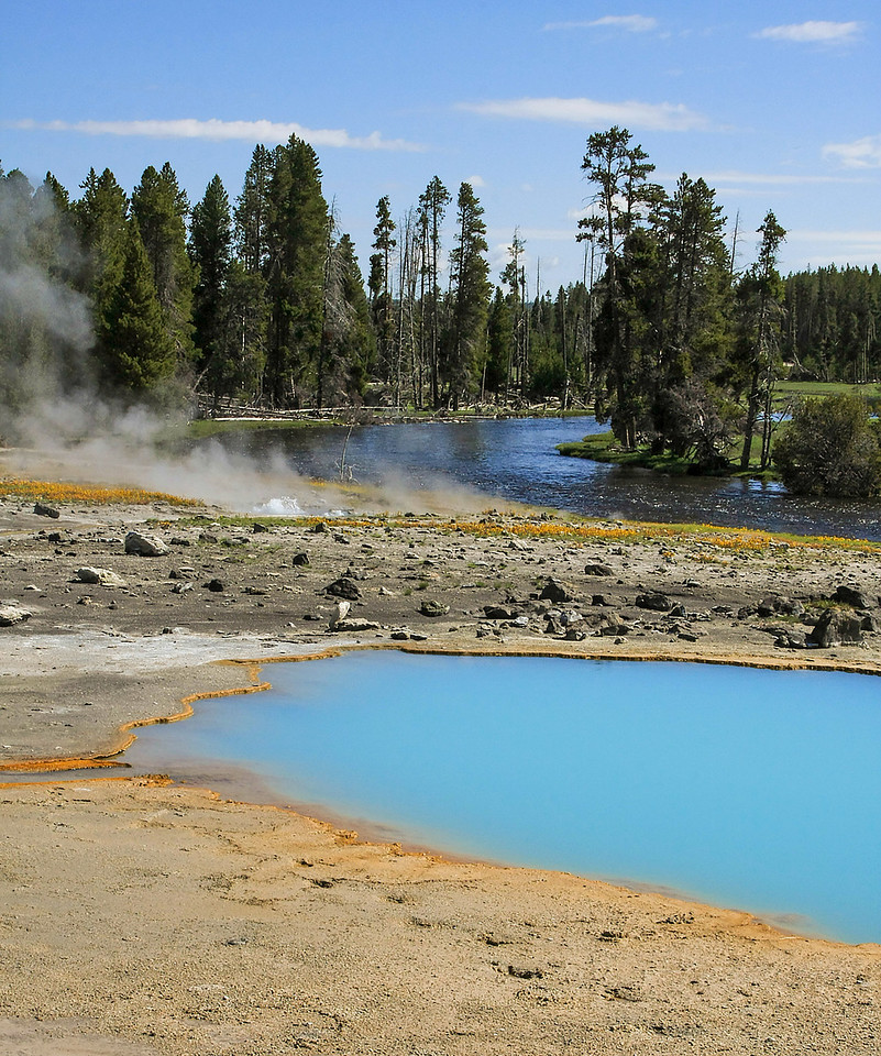 Sapphire Pool and Firehole River in Biscuit Basin