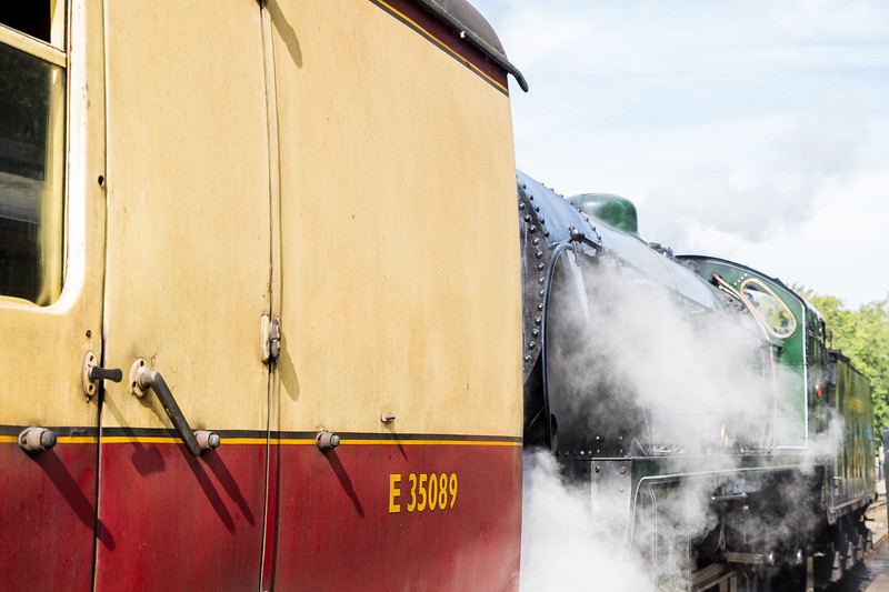 Steam train on the back of a carriage