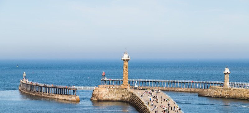 Tourists on the West pier of Whitby harbour