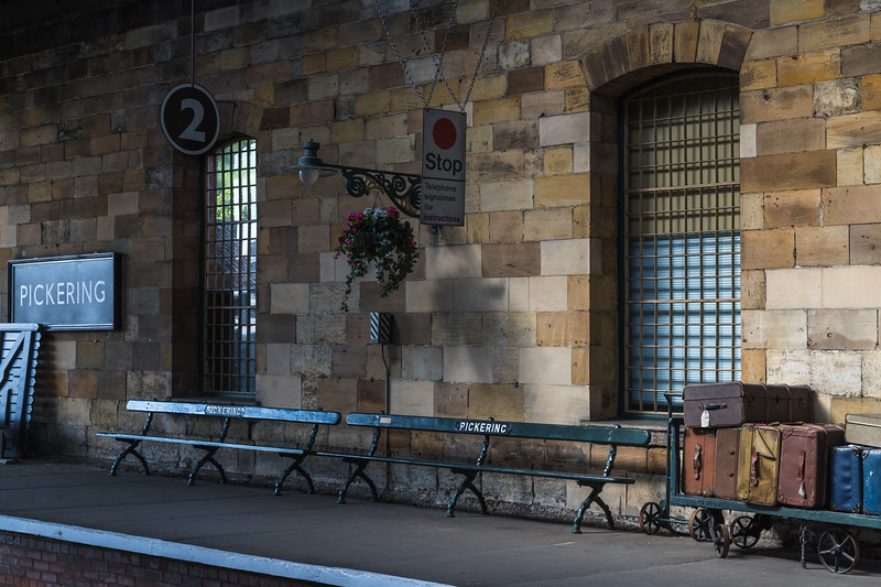 Vintage benches and suit cases at Pickering station