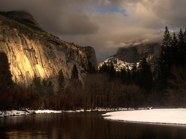 """<center><b>Yosemite - January 2013</b> </center><br>For a brief period this night, the setting sun lit up both the ridge to our left as well as Half Dome. While it doesn't """"pop out"""" in this photograph (partly because of the choice of a wide angle) there is a nice cascade on the left that was lit up by the setting sun."""