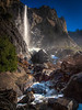 "<center><b>Bridalveil Falls - Yosemite - February 2013</b> </center><br>We took a second trip to Yosemite in 2013, hoping to photograph ""Horsetail Falls"" when backlit at sunset at just the right time of year. Unfortunately, lack of rain contributed to not enough snow melt to create the falls. And the  clouds kept rolling in just as the sun was going down. None of that stopped the hundred or so photographers we saw lined up in various spots but we didn't even try. I did, however, decide to find a new vantage point for photographing Bridalveil Falls. Past photographs were from the more ""tourist"" sort of locations. This time, I hauled myself up and over a rock pile on the far left side of the falls and tried to get as close as possible without killing myself."