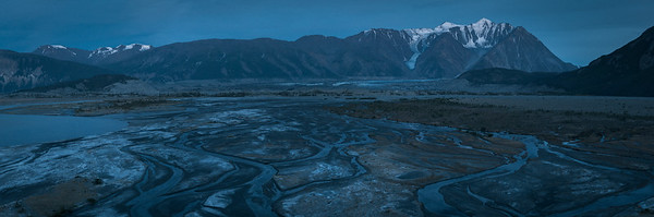 Dusk at the Canada Creek campsite at the end of the Slims River West Trail, Kluane National Park, Yukon, Canada. Off screen right is the base of Observation Mountain which can be ascended to view the Kaskawulsh Glacier.