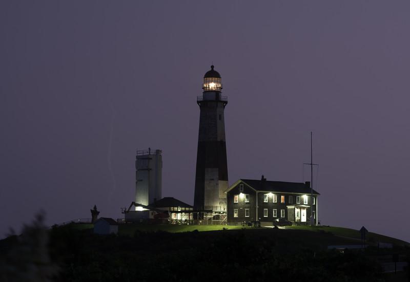 Lightning electrifies the night sky over the Montauk Lighthouse, New York