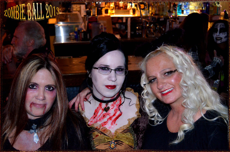 I did not take this photo but still wanted to share :) This is my friends and I at the Zombie Ball!<br /> <br /> Photographer:Chris
