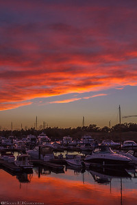 Orange and Gold Sunset Over Marina