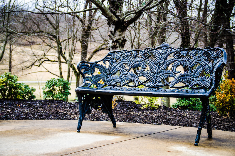 """A bench outside the ticketing """"house"""" at the Biltmore Estate"""