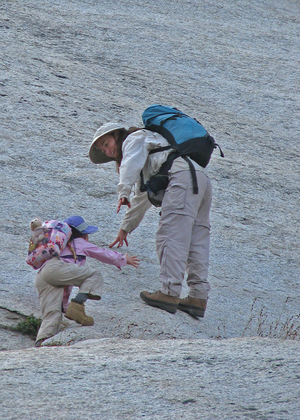 Action photo of mother and daughter climbing the Silliman slabs