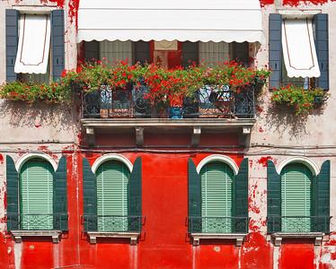 Windows and flowered balcony (Murano, Italy 2011)