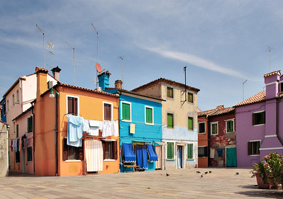Old orange and a fresh orange with a blue in between (Burano, Italy 2011)