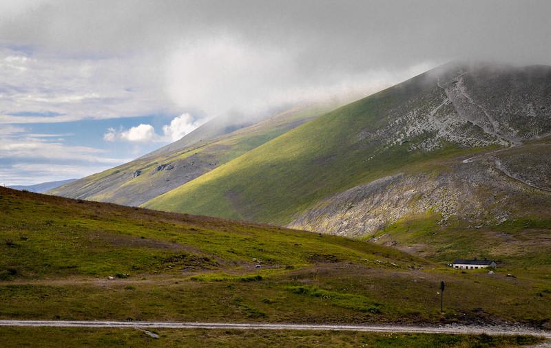 Rain stopped by the mountain ridge  (Forca di Presta pass - 1540 m above sea level - on the eastern approach from Pretare to Piano Grande di Castelluccio, Italy, 2012)