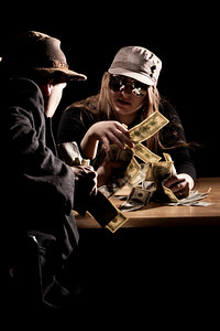 "January 18, 2012. Day 12.  John entitled this ""The Money Grubbers."" He really did all the work for this photo (as in lighting genius, posing, framing, the idea in the first place), I just messed with my aperture and pushed a button. We started a timer, and start-to-finish, throwing up lights as fast as we could and making total mayhem of our apartment, it took us about 50 minutes. Good work, John! I'm definitely blessed to be married to a photographer.  Wasilla, Alaska"