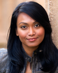 3/11/2012, Actress headshot, Palace of Fine Arts, San Francisco  I was taking pictures for my lovely wife, Jacintha Charles, at Palace of Fine Arts in San Francisco. I was looking for a location where I could get a natural warm glow and this place has big yellow/beige pillars that reflect afternoon sun very nicely. I did a quick touch-up on the photo and it should be to be used. Let's see what the customer says.