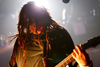"Korn, The Warfield, San Francisco, 3/4/2012  James ""Munky"" Shaffer from Korn. This was the only gig I shot the whole week and it was technically very hard. Korn uses very small spotlights and a lot of strobing lights from behind. It was hard to catch a moment when the musicians were light and the back light didn't overpower the shot. One technique I us in this king of situations is to try to hide the background light behind the musicians. This created nice halo's around them and allows me to capture the faces with the little light that is available."