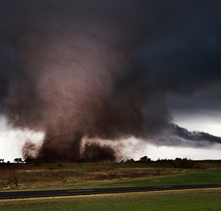 This picture was taken on one of my best storm chases of my life on 11-7-11 in south west Oklahoma near the small town Manitou. When this picture was taken; I was less than a half mile from this large tornado. Fortunately this tornado did not damage any homes. Camera info:  Cannon t2i with a Sigma 10-20mm wide angle lens.  Brett Wright Woodstock, IL