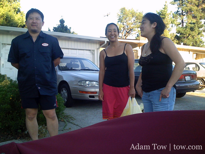 Kai, Rae, and Petrice outside the house