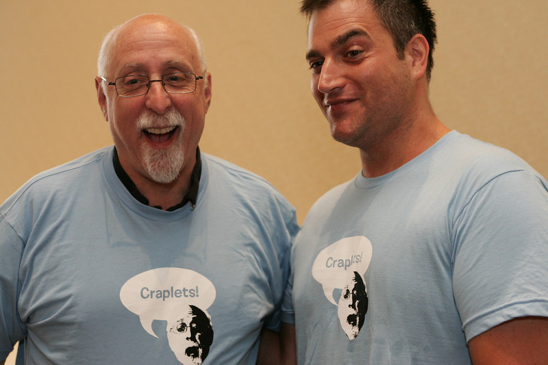 Walt and John share a laugh while wearing their Craplets t-shirts