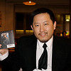 Kai holds up his new black iPod video.