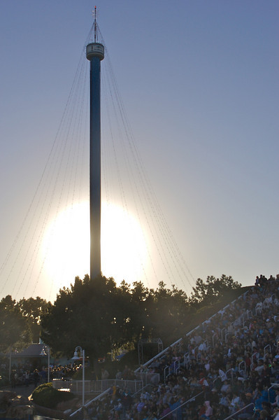 The sun crosses the Space Needle tower at Sea World.