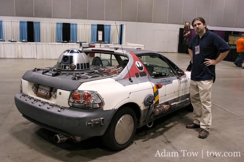 Mark standing next to a Rebel fighter art car at Star Wars Celebration IV.