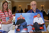 Walt Mossberg holds up a poster print of Steve Jobs and Bill Gates taken during their joint interview at D5.