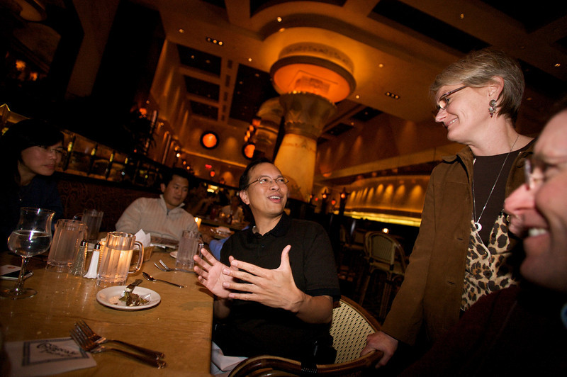 Jon shares a laugh with Julie during the Palm Content and Access Holiday Reunion.