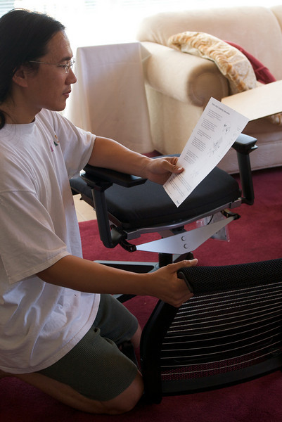 Reading the very short assembly manual for the Think chair.