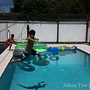 Ryan jumps into the pool.