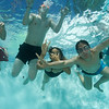 Hard to coordinate four people underwater.