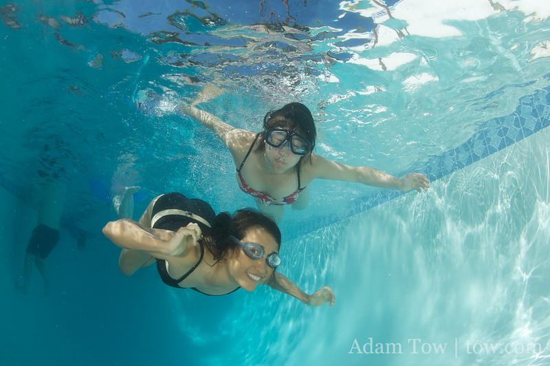 Rae and Petrice swim to the camera again.