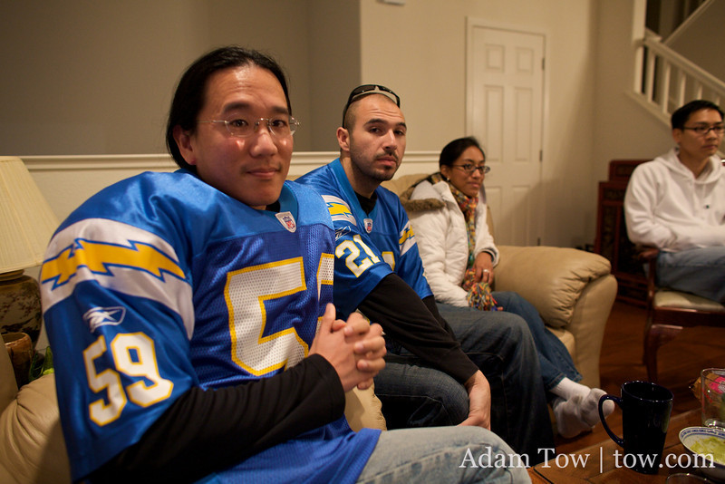 Getting my shoulder pads on with fellow Charger fan, Dan G.