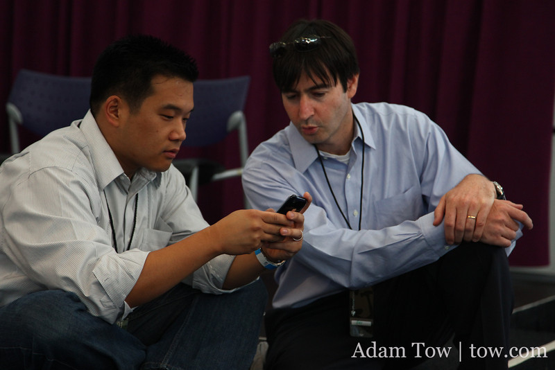 Chi-Hua Chien from Kleiner Perkins goes over something on his iPhone before his keynote presentation.