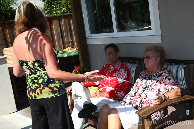 Lana talking to guests at her parent's 40th anniversary party.