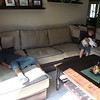 Tyler and Ryan lounge in front of the TV.