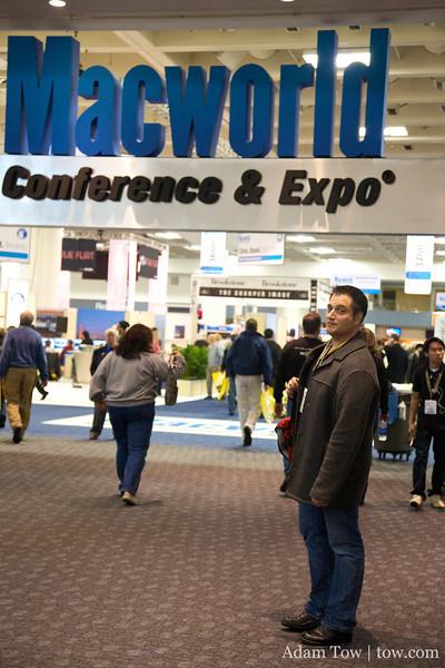 John in front of the Macworld logo