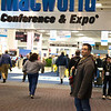 John in front of the Macworld logo