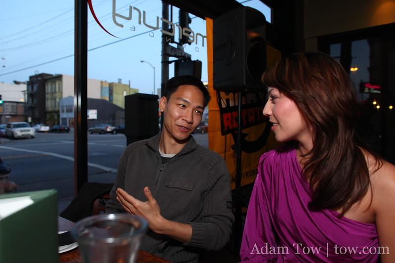 Felix talks with Cheryl as the sun goes down in San Francisco.