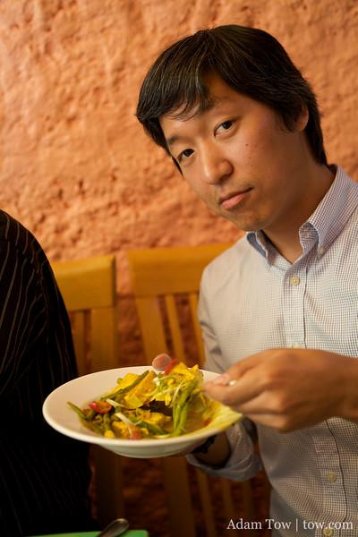 Joon-Mo finishes off the curry tofu.