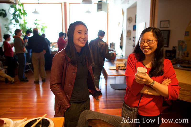 Rae speaks with Nancy Hom at Somei Yoshino's Open House in Oakland.
