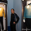 Adam in front of Kirk and Spock's uniforms.