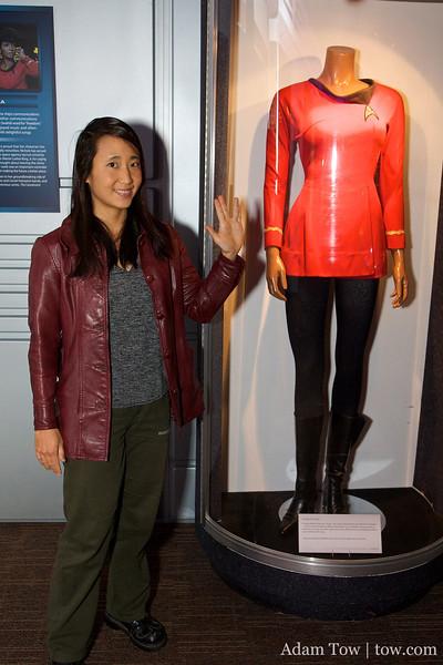 Rae stands next to Lieutenant Uhura's original costume from Star Trek.